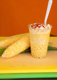 Elote - a scrumptious creamy corn cocktail garnished with lime.
