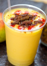 Trolebus de Mango - a smooth mango blend topped with savory chamoy.
